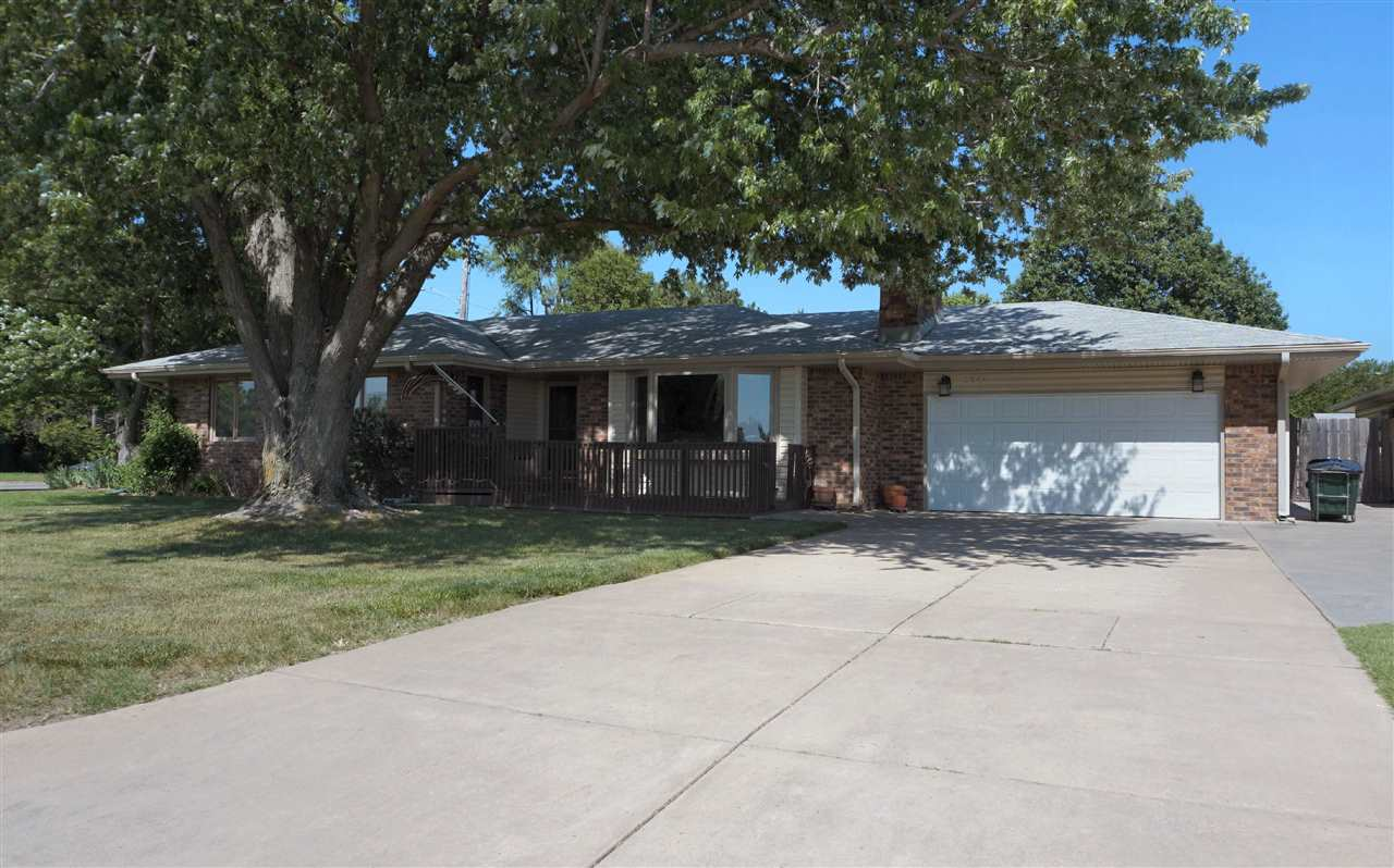 A beautiful neighborhood with large, established shade trees is where you will find this spacious, 3