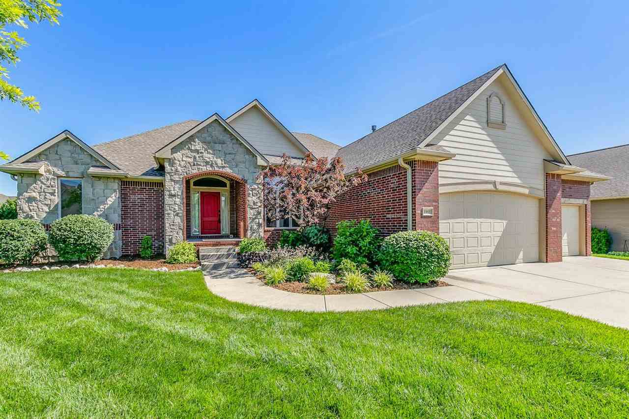Great 4 bedroom home sits on a corner lot in one of Wichita's best neighborhoods...home looks brand