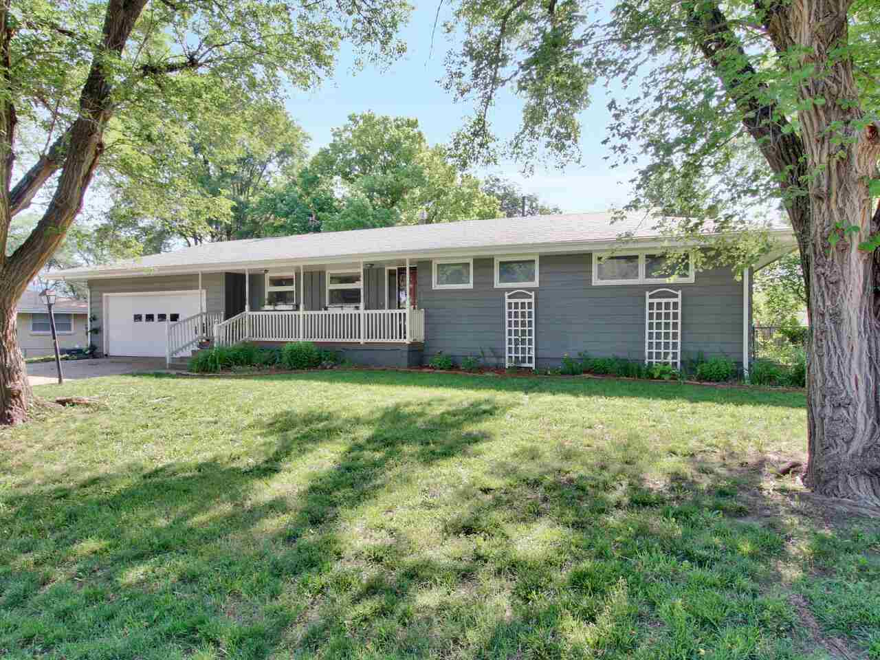 What a charmer!! This darling ranch style home has 3 bedrooms, bath and a half on the main level wit