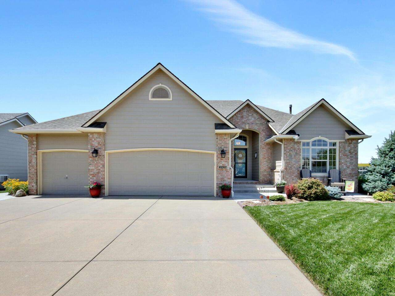 Pride of ownership and beautiful updates accentuate this Derby home! Lovely landscaped flower beds,