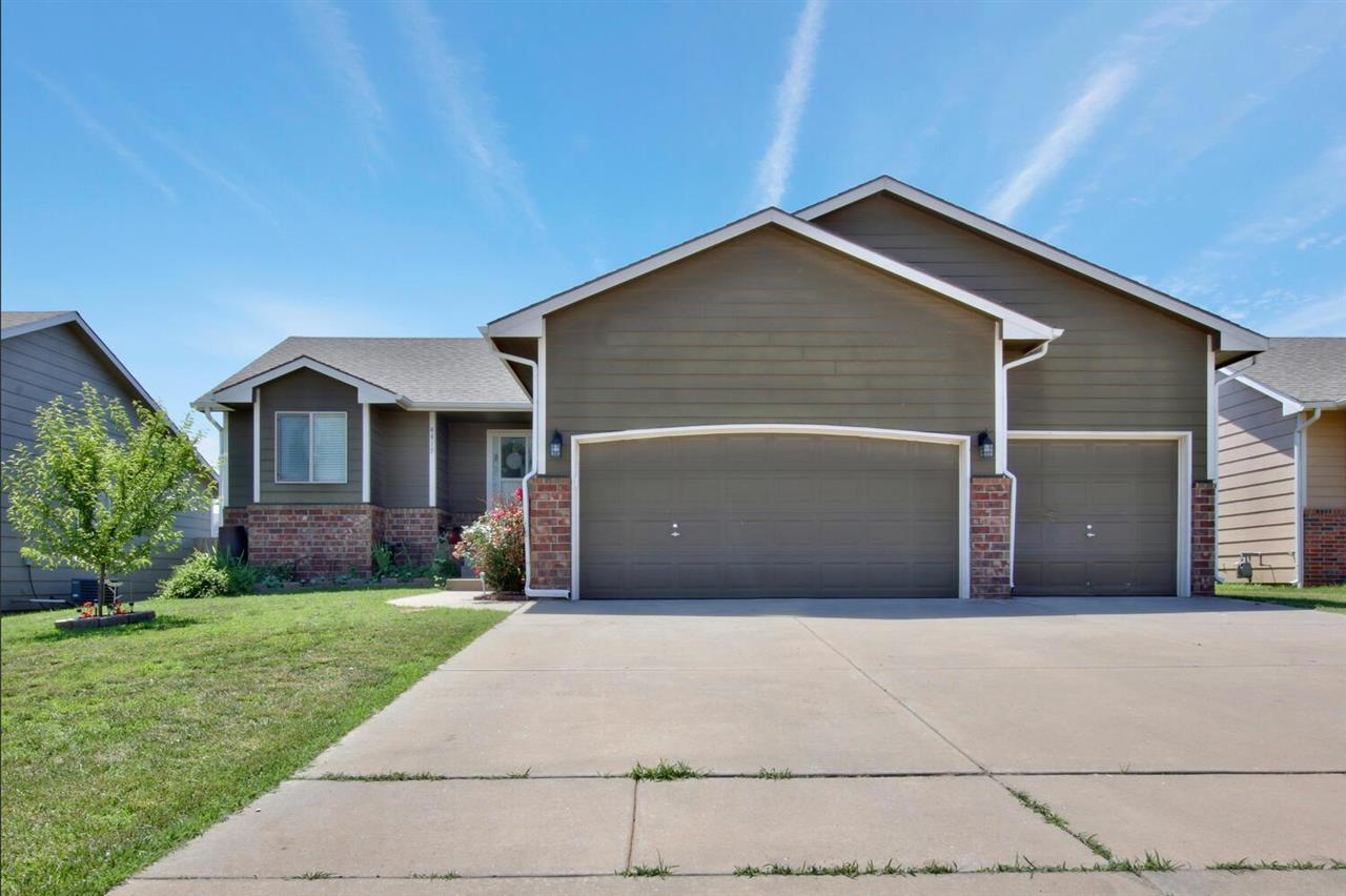 Delightful Ranch with five bedrooms, three baths, and three car garage.  View out basement with room