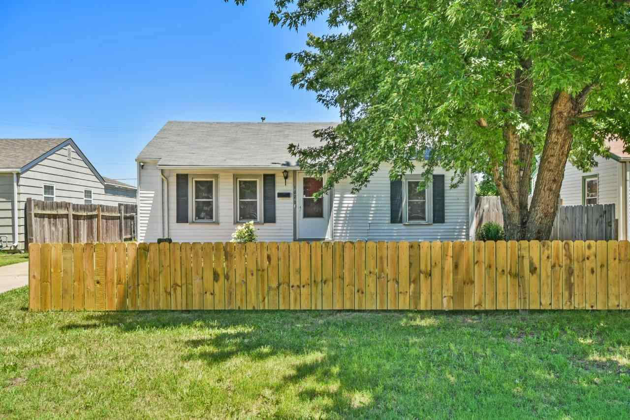 Cute home, move in ready! Hard wood floors, Tile in kitchen and bathroom with an Extra large master