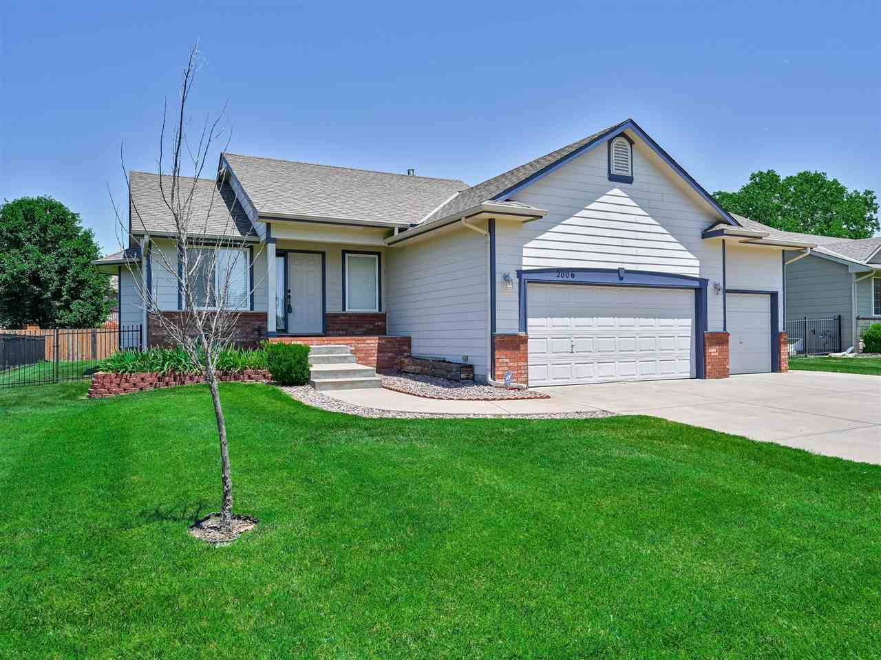 Turn-key and meticulously maintained 4 bedroom, 3 full bath, three car garage home with fenced backy