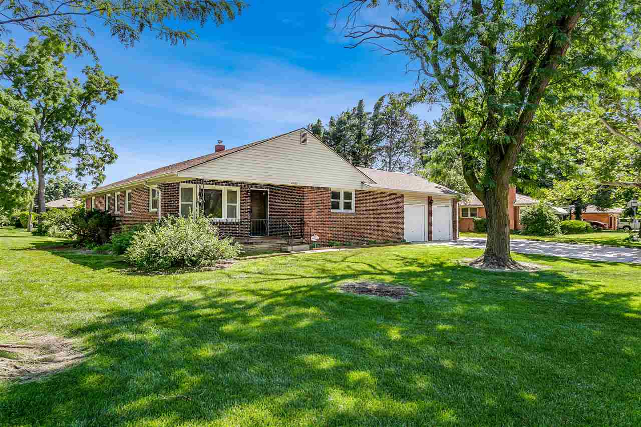 Lovely brick home located on a .45 acre corner lot.  This home has not only as attached two car gara