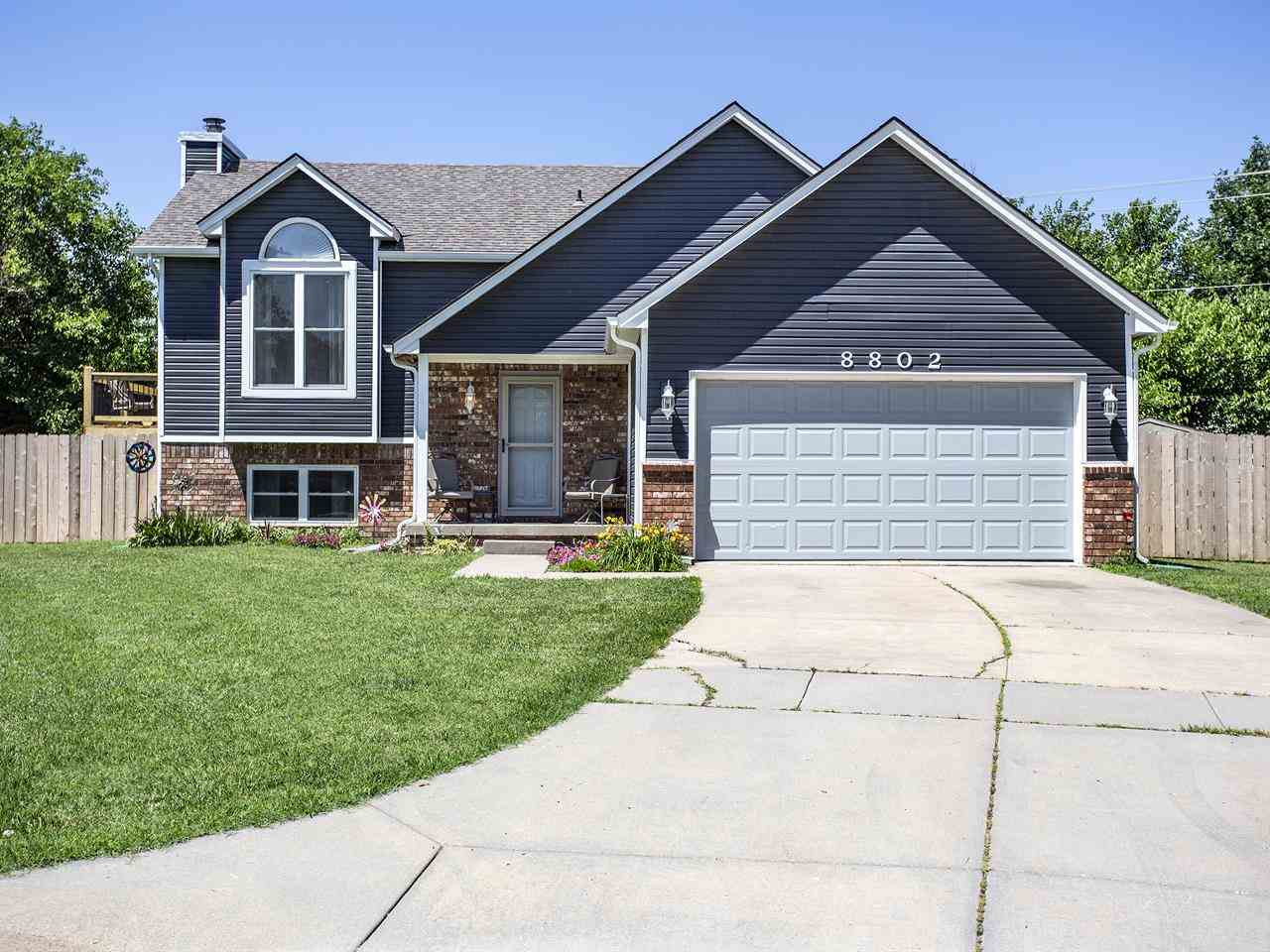 You have to see this spacious 4 bedroom 3 bath home in the Derby school district!  This lovely home