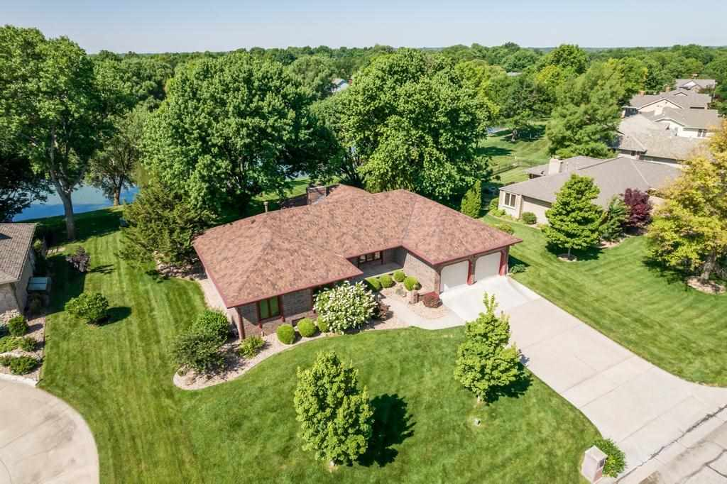 This spacious custom-built home, with a huge lake lot and dock is solidly built and ready for you to