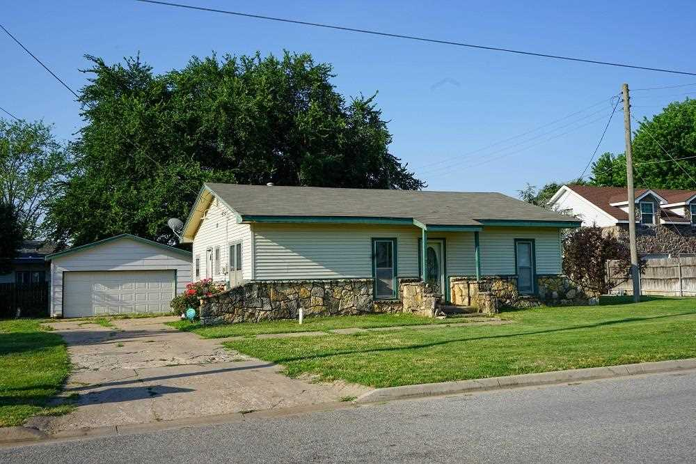 Charming 2 bedroom home with a bonus room and 1.5 bathrooms, situated on a corner.  There is an over