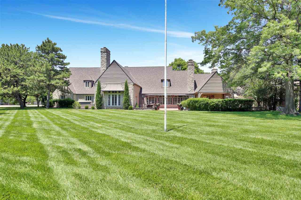 Situated on 1.54 acres, this iconic Wichita residence was once home to the original polo grounds.  B