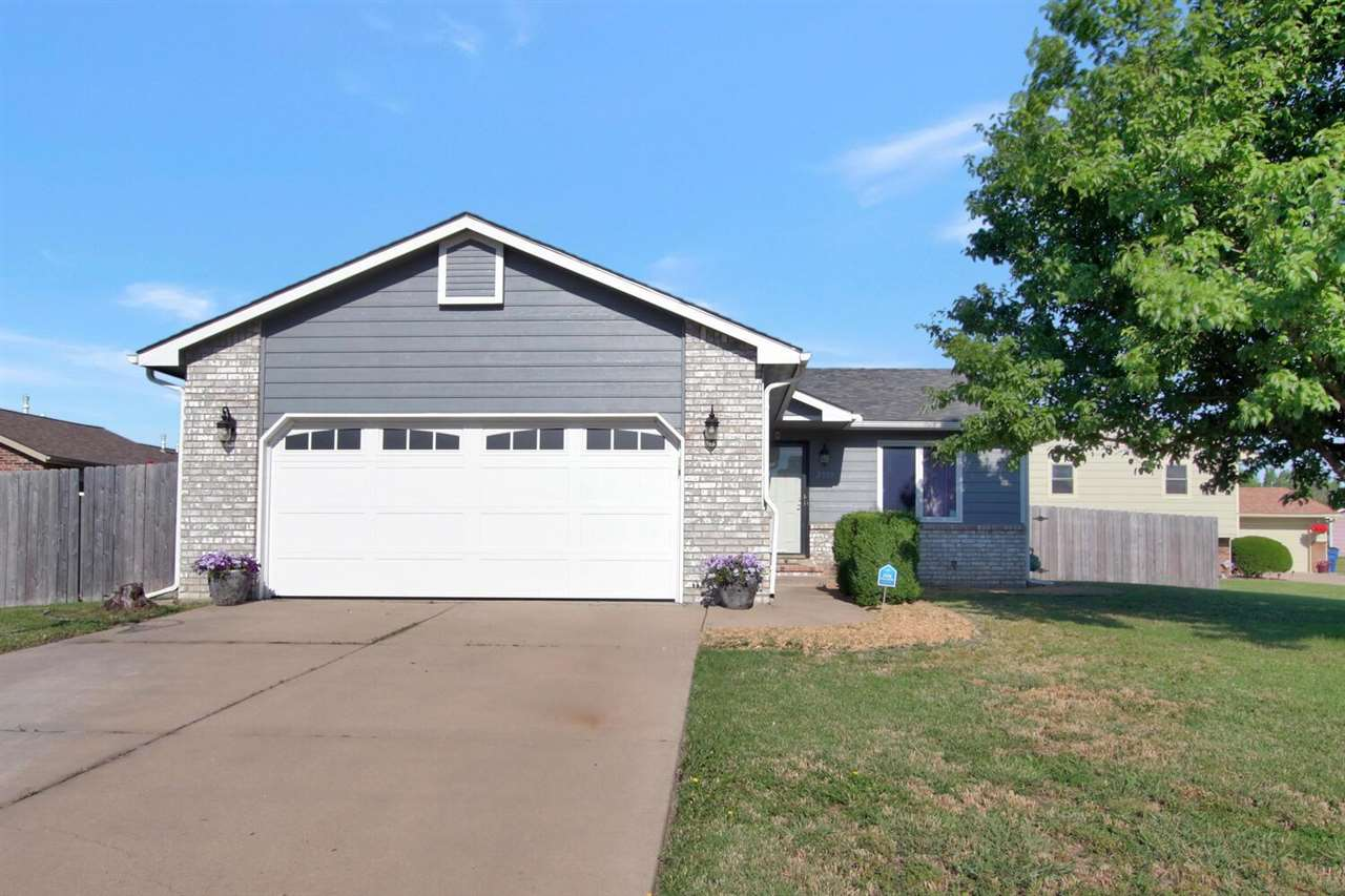 This immaculate east side 3 bedroom 2 bath home offers tons of curb appeal and has a lovely modern d