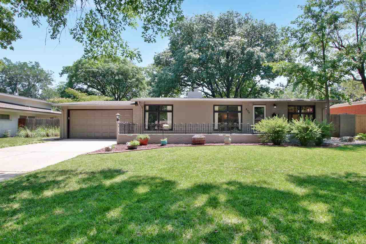 Gorgeous Mid Century Modern home in Woodlawn Village! 3 bedroom, 2 bath with 2 car garage. Beautiful