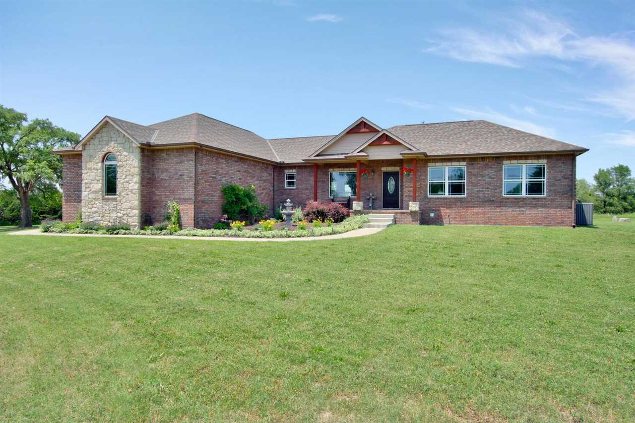 A RARE FIND!  Beautiful, spacious, custom home on almost 10 acres just 15 minutes south of Wichita i