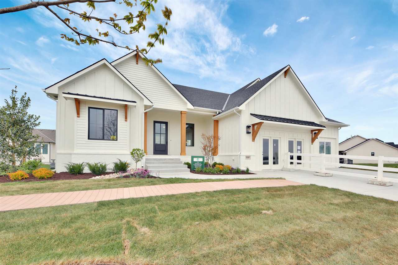This beautiful model home is open 7 days a week!  It has a modern craftsman elevation.  In the livin
