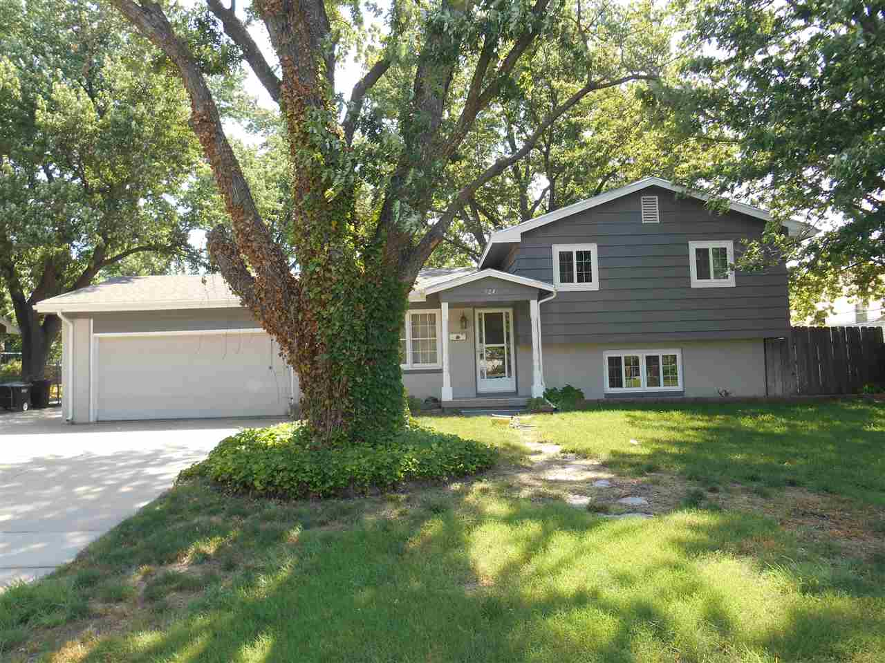 NICE ROOMIE SPLIT LEVEL HOME THAT OFFERS THREE BEDROOMS UP AND ONE BIG MASTER SUITE/ FAMILY ROOM ON
