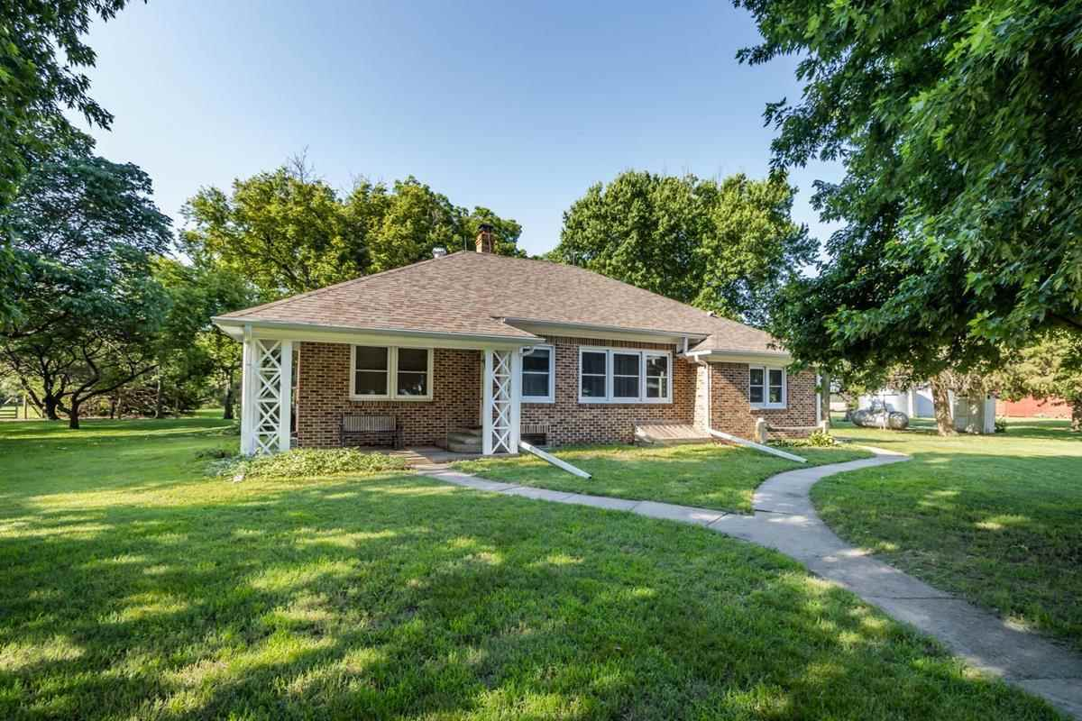 Welcome home to your very own 7 acre rural farmstead on blacktop!  This brick home is VERY spacious
