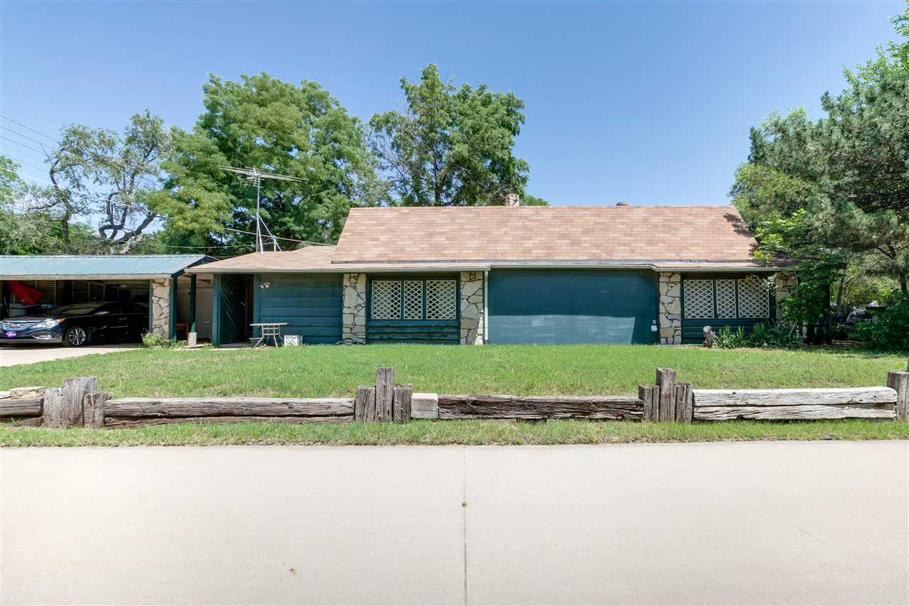 As you pull up this long drive with diamond shape fencing, you will find a unique ranch home that is