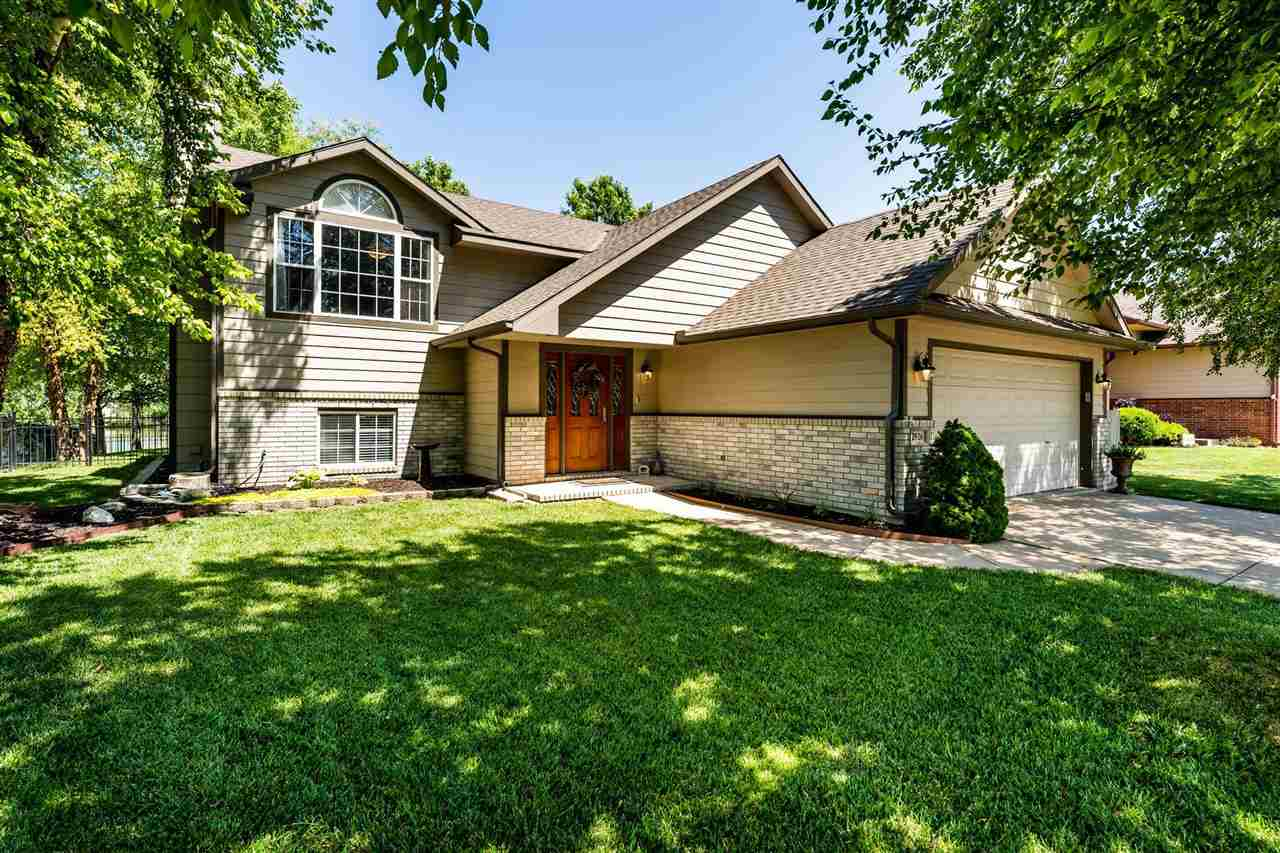 Waterfront home in Evergreen addition! Right in the heart of New Market Square you'll have all the a