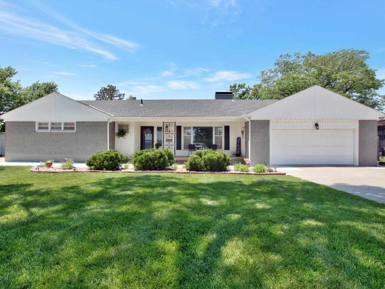 Welcome to 447 S. Windsor. This magnificent 3 bedroom, 3 bath, sprawling ranch style home is nestled
