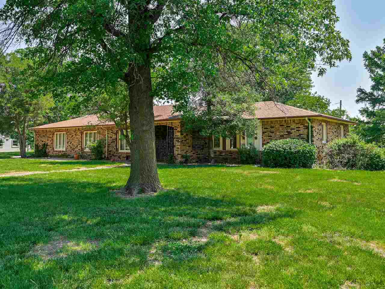 Unique, sprawling ranch brick home on almost one acre of land! This 1970's home offers 4 bedrooms, 3