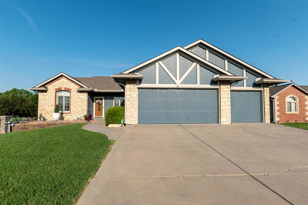 Former Model Home with all the upgrades!  ZERO level entry!!!  No stairs to front door or garage!  9