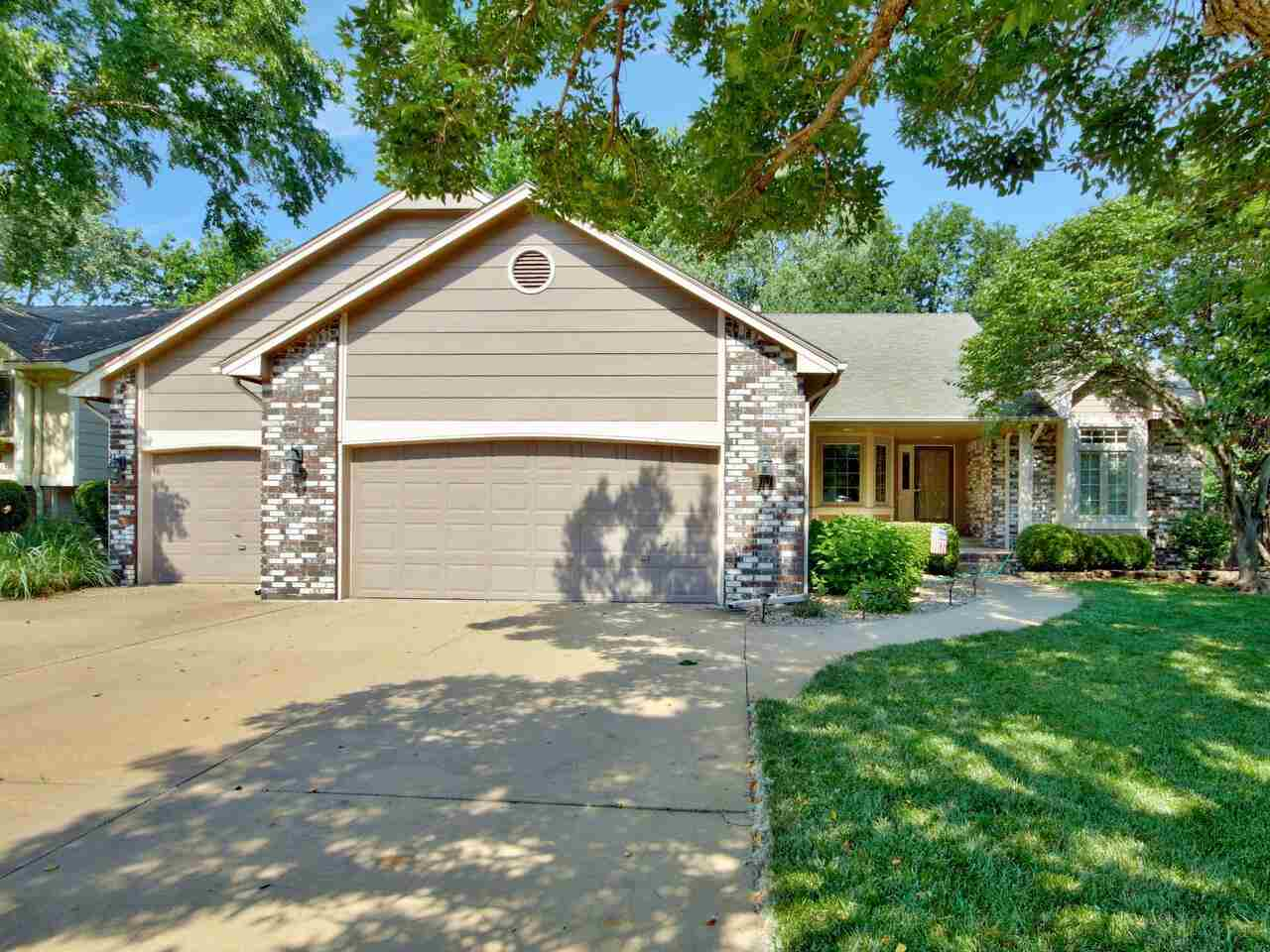 Lovely 4 bedroom, 3 bath ranch with fireplace, formal dining, eating space in the kitchen, vaulted c