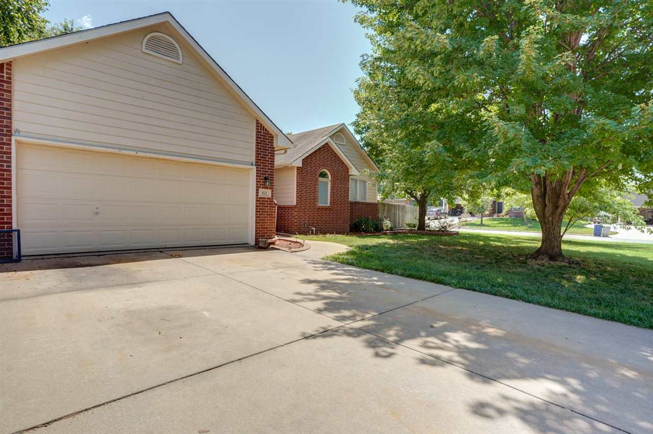 Valley Center Schools! This 4 bedroom home is located in the heart of the quaint Valley Meadows Addi
