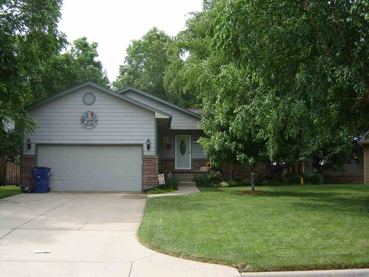Beautiful home in Maize School District. Oasis in the backyard. Look off the covered deck looking ou