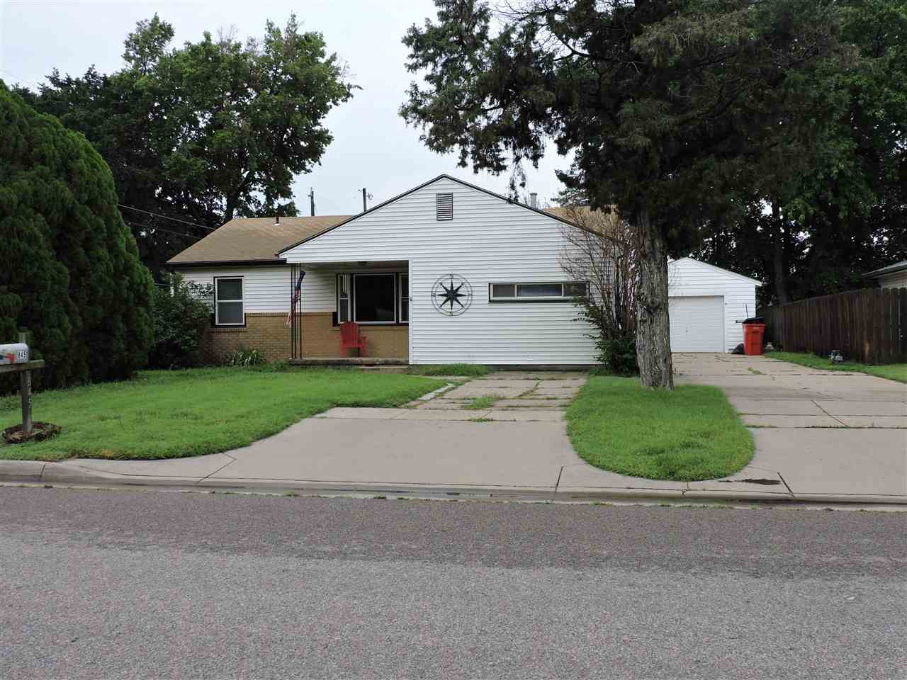 Cute 2 bedroom, 1 bath home with main floor laundry and additional finished room for family room or