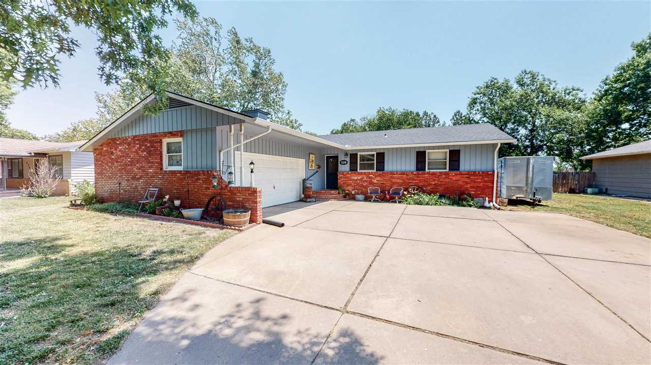 Charming home located in Halstead, KS.  Don't miss your opportunity to with over 1,300 sq ft on the main level.  Updated kitchen with custom island, eating bar, this home.   Living room dining room combo with brick fireplace.  2 large bedrooms on the main level with 3 non confirming rooms in the basement.  Updates through out