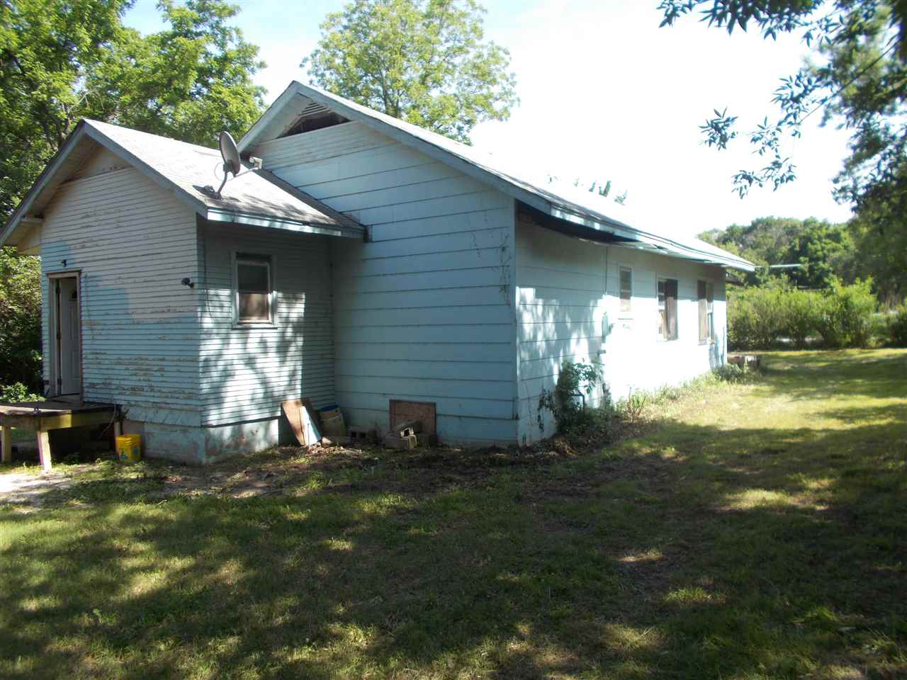 Wow what a fixer upper.  This property is a great buy.  This has 4 bedrooms 1 bathroom on one lot.