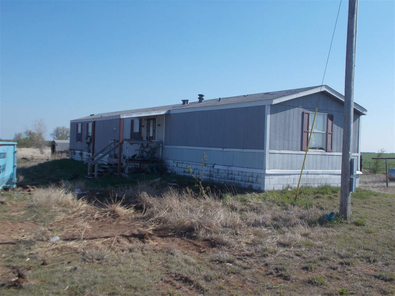 Single Wide Mobile Home on Permanent Foundation.  Home needs lots of love.  Could be taken out and b