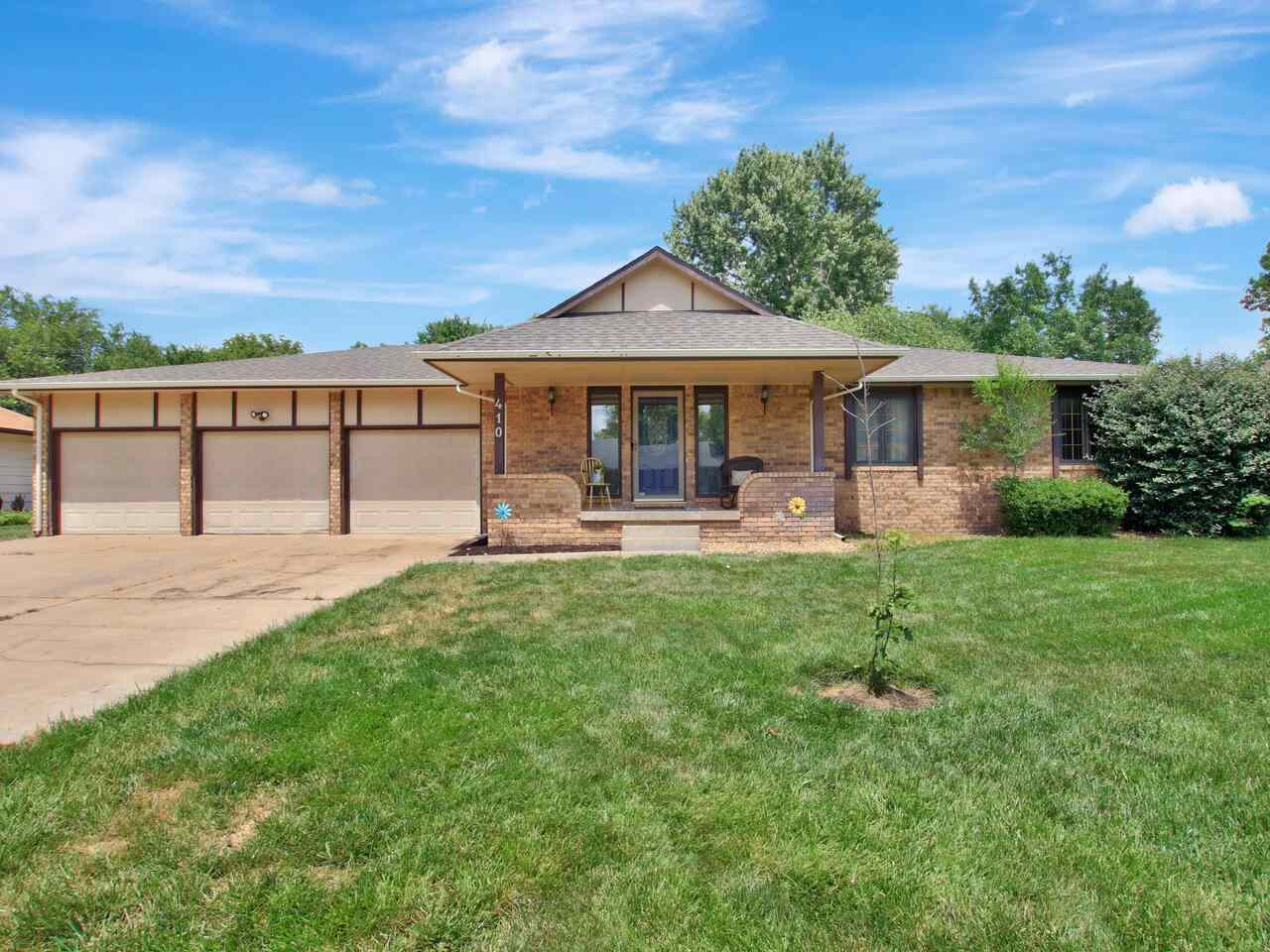 Beautiful custom ranch on secluded pond in West Wichita. Walk in and you'll be greeted by the giant