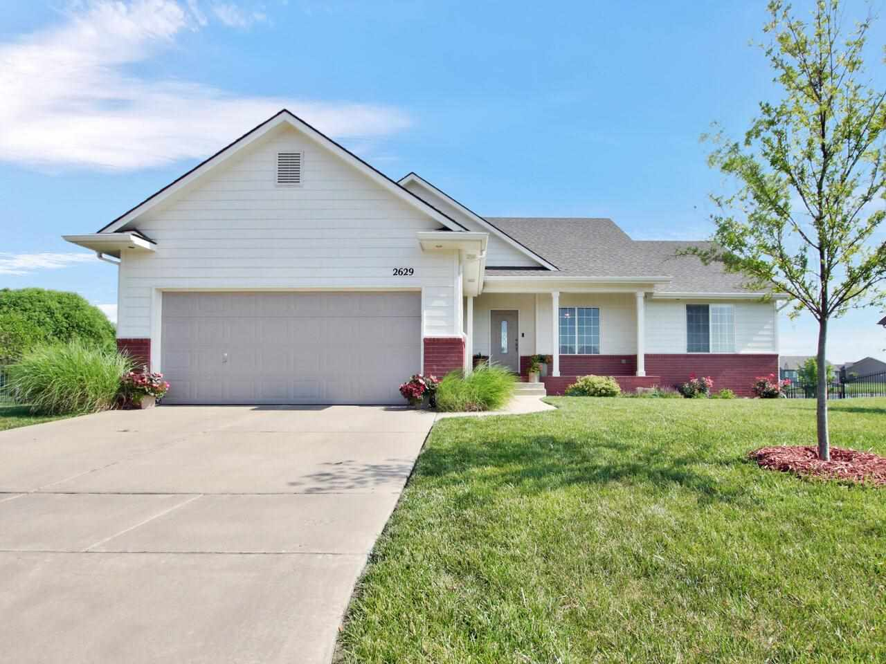 Perfectly set on a lake lot, this Northeast Wichita beauty is turnkey and full of natural light. The