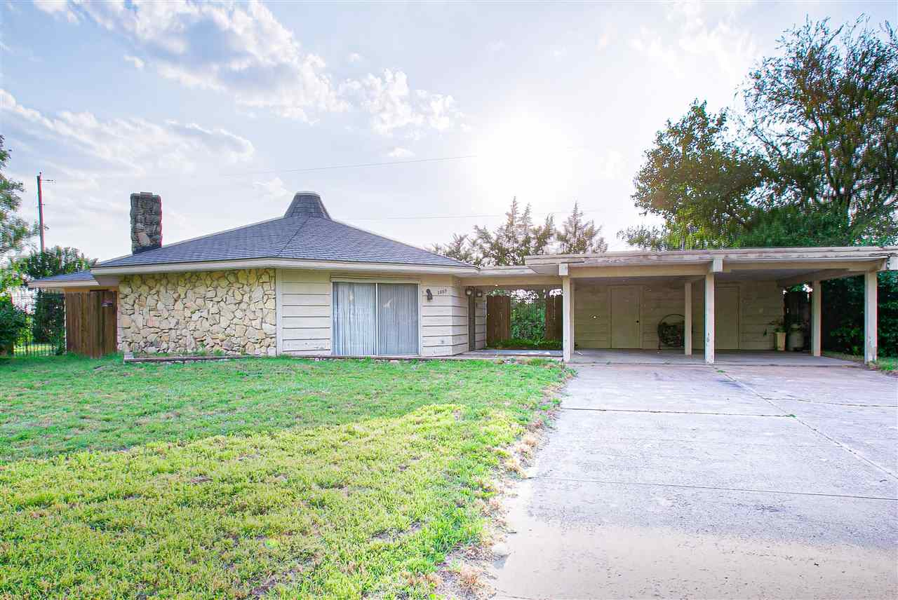 Here's your opportunity to own a unique octagonal, retro home complete with beamed ceilings, sunken