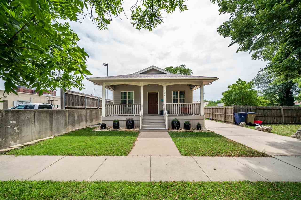 Welcome home! This darling east-side, like new bungalow sits on a great lot with a large, private ba