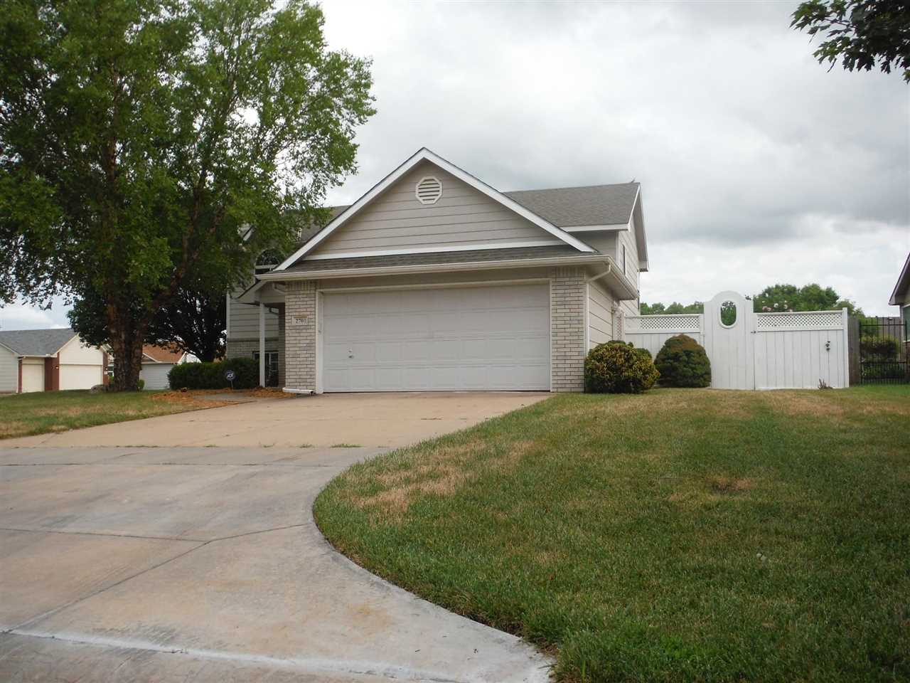 4 bedroom 3 bathroom home on a corner lot with tons of extras. Brazilian walnut flooring on the uppe