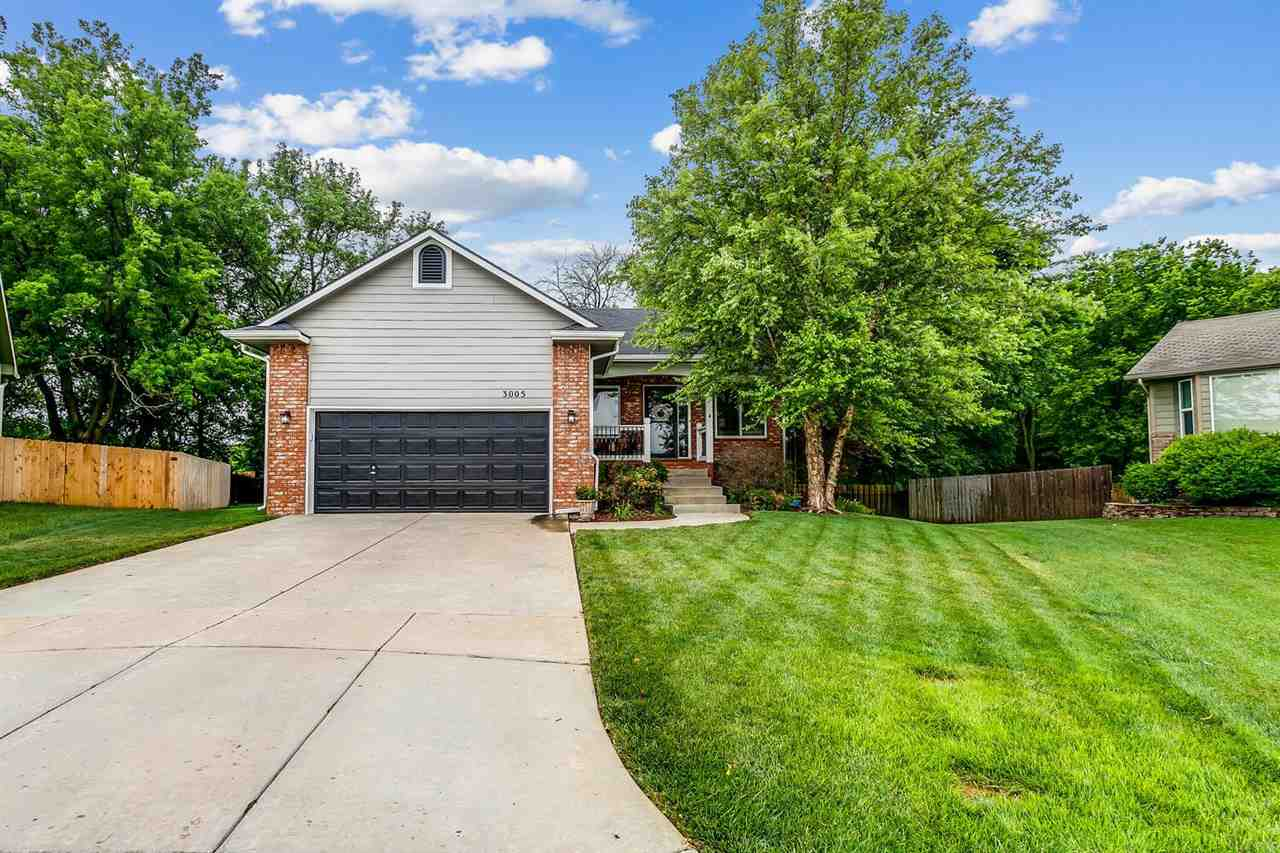 This lovely house sets in highly desirable Falcon Falls subdivision. Sitting in the heart of the NE