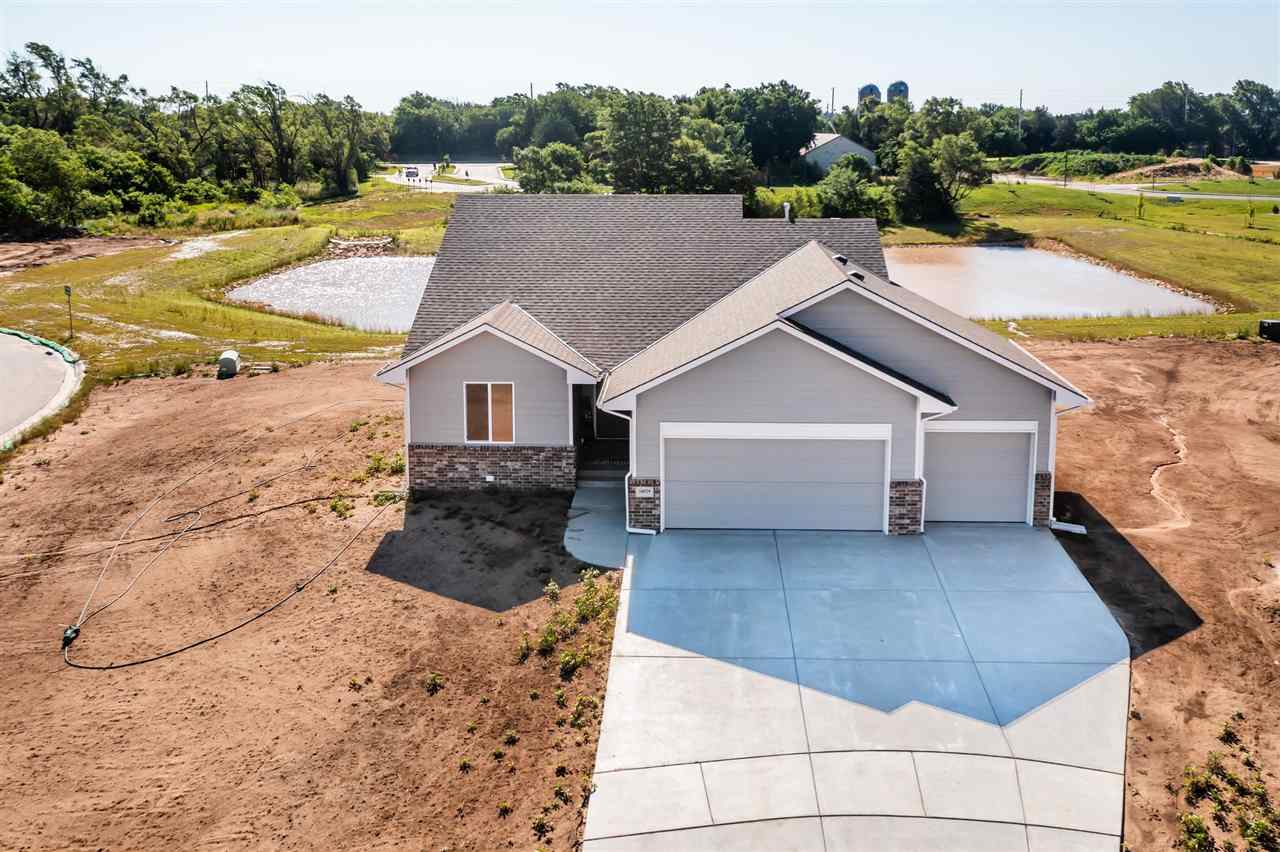 MAIZE SCHOOLS ... NEW BUILD ... CORNER LAKE LOT   Man! You just don't see a move in ready home like