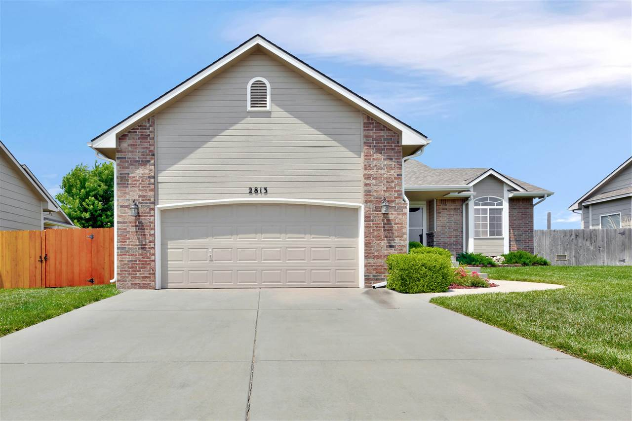 Welcome home! This split bedroom home shows like a dream! Open kitchen design, main floor laundry an