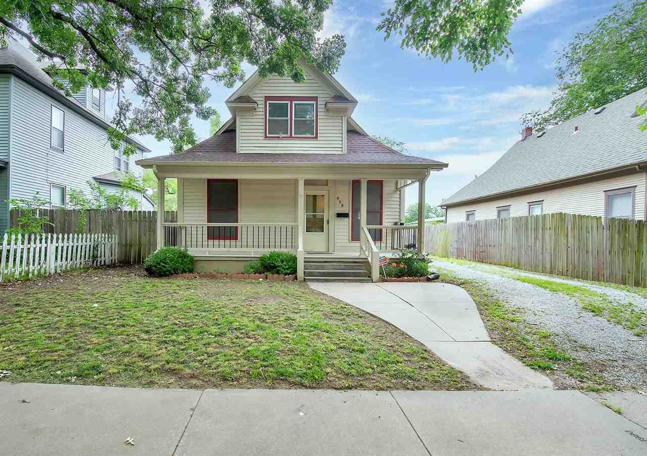 Welcome Home to this Blissful Bungalow! Just minutes away from the Riverfront Stadium, Arkansas Rive
