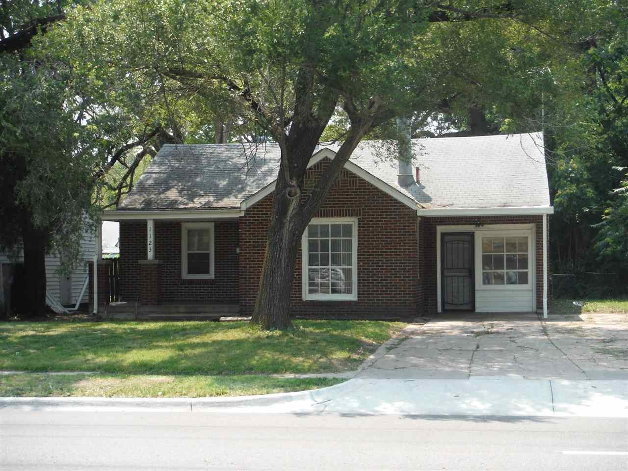 3 bedroom 1 bathroom full red brick home that is move-in ready. Covered front porch with a security