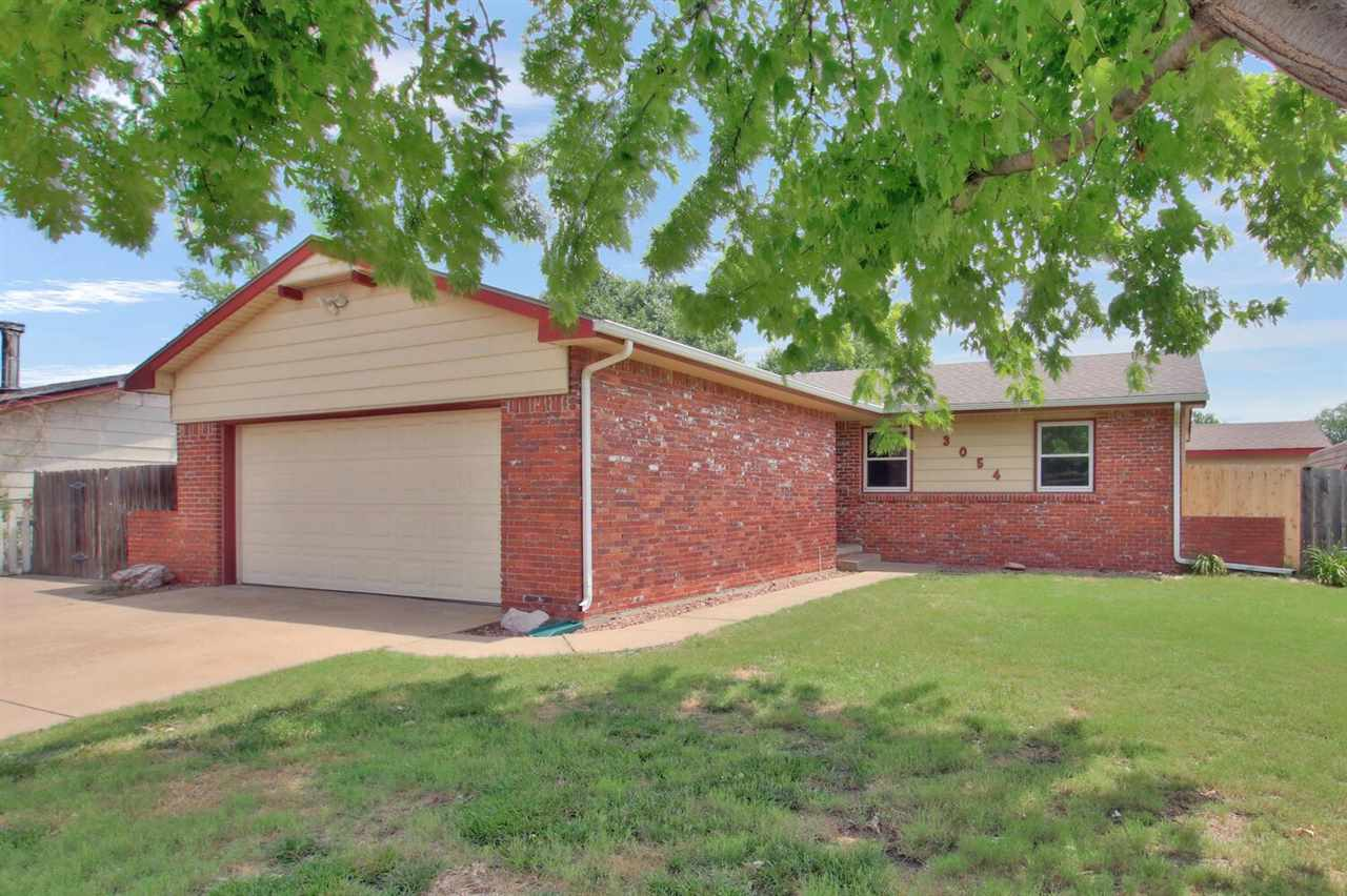 This delightful three bedroom home is situated in a quiet neighborhood in south Wichita on a corner