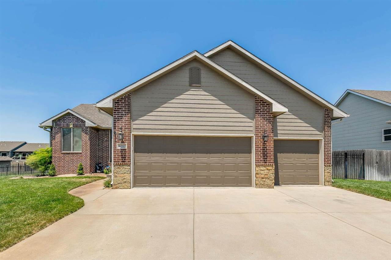 Wow!  This home underwent a total, professional kitchen remodel and wet bar addition in 2018 and shows like a dream!  Hurry in to see this 5 bedroom, 3 bath, 3 car garage home in the popular Edgewater neighborhood in the esteemed Maize School District.  This home has a fantastic split bedroom floor plan with open living spaces making it easy to entertain family and friends.  The expansive island with quartz countertops are perfect for kitchen preparations as well as a space to gather or decorate cookies with the little ones.  Other special upgrades include hardwood flooring, high-end, smudge-resistant slate appliances, a farmhouse kitchen sink, and closet pantry.  The main floor laundry room (washer and dryer negotiable) features a custom-built organizer and drying rack to help keep the main living space looking like the oasis it is.  The master bedroom has his-and-hers closets and comfortably accommodates a king sized bed.  Two additional bedrooms on the main floor share a hall bath.  Downstairs the rec room and wet bar in the basement is #goals.  It features a dual sided refrigerator (can be set at two different temperatures), wired in LED under lighting, and ample storage.  Two additional bedrooms, a bathroom, mechanical storage, and an unfinished storage room round out the view out basement.  Outside, you've got it all:  an oversized stamped and stained concrete patio, 12x16 deck, well and irrigation system to keep the grass green and water your water bill low.  Not to mention a wooden playground set that is less than 3 months old!  Residents have access to a neighborhood pool and stocked fishing ponds, as well as a clubhouse that can be rented for personal use.