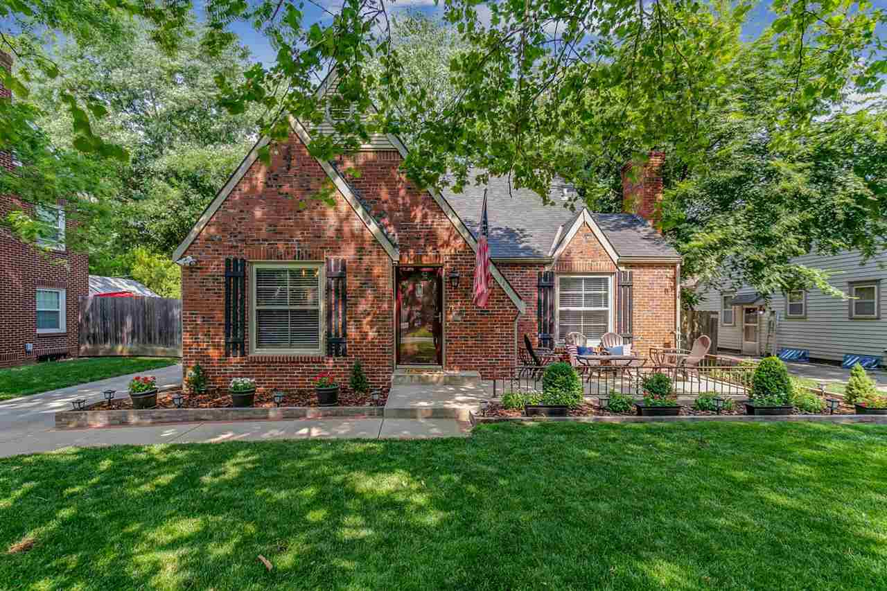 Charming and move-in ready!!!  Awesome curb appeal is enhanced by a full red brick exterior, big fro
