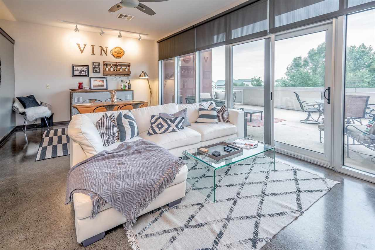 This charming WaterWalk condo is what downtown living is all about!  This unit is located on the 2nd