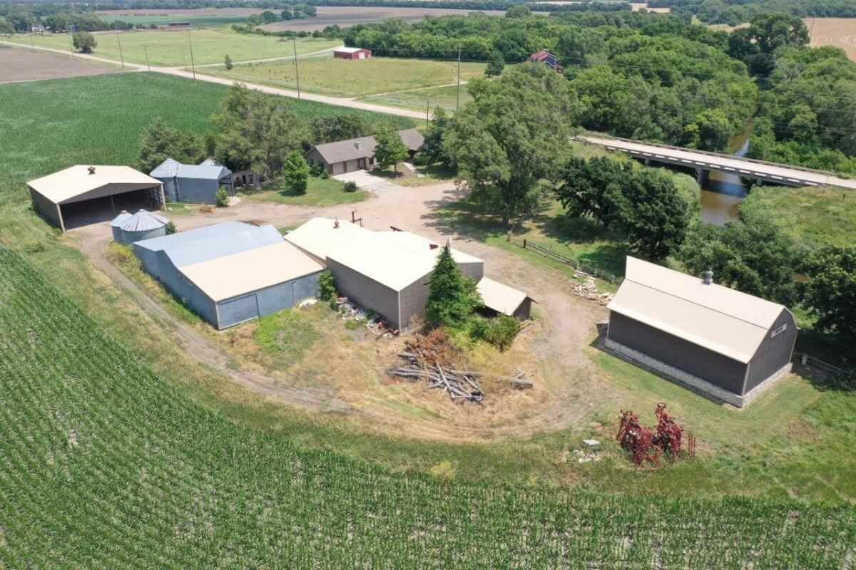 Brick ranch style home on 7+- acres with several quality barns, buildings, grain bins, and history.