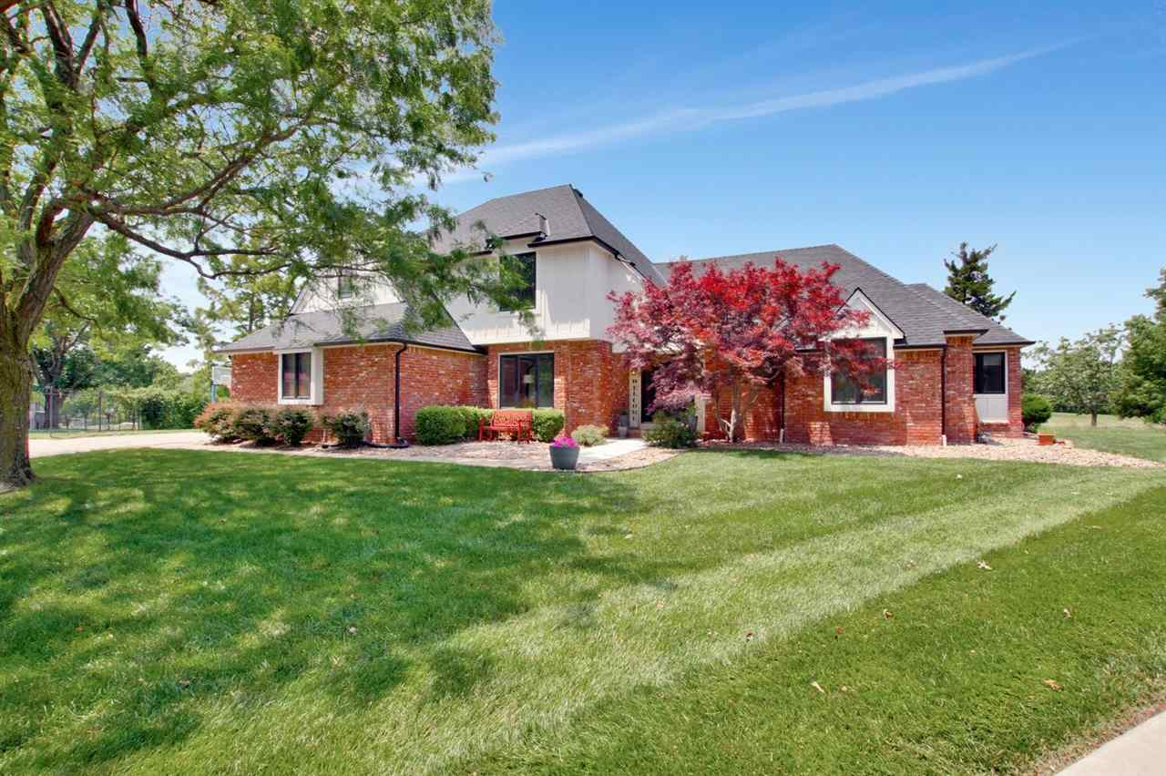 This GORGEOUSLY RENOVATED home sits on a quiet cul-de-sac on the Tallgrass Country Club Golfcourse... not only do you have private, sprawling views, but this property is BETTER THAN NEW... ** NEW ROOF (2021) ** NEW SIDING & EXTERIOR PAINT (2021) ** ALL NEW VINYL WINDOWS & SLIDING DOORS (2021) ** COMPLETE MASTER BATH REMODEL & NEW GRANITE IN BATHROOMS (2021)** ALL NEW CARPET IN BEDROOMS (2021)** NEW REMOTE CONTROLLED WINDOW BLINDS ** Grand staircase entryway opens up into the vaulted spaces throughout. Front sitting room (or make it your formal dining space!), large beamed living room with floor-to-ceiling windows, open concept to the kitchen and two separate eating areas; one adjacent & casual right off the kitchen, and another more formal space for hosting a large group. Master bedroom holds a newly-renovated en suite with soaker tub, 3 separate closets, and tiled shower. BONUS dressing room off the master bedroom is also perfect for a den/office space, or a nursery! THIS is an amazing room! Gourmet kitchen includes Dacor double ovens, gas range with pot filler, sub-zero refrigerator, and a Bosch dishwasher. Hidden cabinet pantry space and utility island. Separate laundry & mudroom space is perfect for organizing! Upstairs bedrooms are full of character with a Jack & Jill bathroom with separate (adorable!) tub/shower room fit with even a chandelier! Another 4th bedroom up holds its own full bathroom space as well. Basement family room and rec spaces allow for many uses and has partially heated floors! Large 5th bedroom downstairs with another full bath, and a BONUS workout space and batting/hitting practice space! Tons of storage aside from all of this. Aside from the obviously beautiful views of the 14th hole fairway and golfcourse hills, the backyard space also has a sprawling covered patio space, gas stove hookup for future outdoor cooking use, playset area for little ones, and plenty of room for entertaining! The south side of the home's lot has also been zoned
