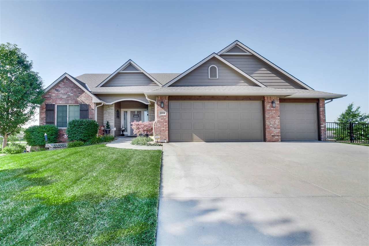 You'll love this immaculately cared for zero-entry, ranch style home in the Oaks - Derby.  It's coun