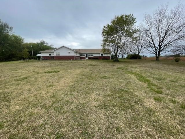 House and approximately 4 ACRES m/l, One owner home, 3 Bedroom, 2 bath, 3 car garage, rural water, s