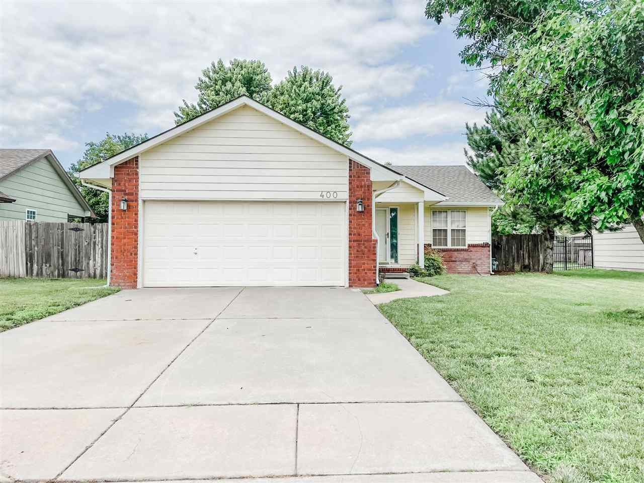 Looking in Valley Center? Check out this 2 bedroom, 2 bath ranch home with 1655 square feet in a beautiful neighborhood. Home has vaulted ceilings as you enter with master and 2nd bedroom and bath on the first floor.  The kitchen near the back has a cute nook surrounded by windows where you can enjoy your meals looking outside. Access to front and back have few steps. Basement offers a nice living room with laundry area. And a 3rd bedroom and 3rd bathroom are roughed in ready to be finished to add immediate square footage to the home. The backyard offers a tree-shaded,  fully-fenced yard with sprinklers on irrigation well.  Brand new roof put in 2021.  This is a one-owner home and located on a beautiful street. So many amenitites right around the corner from this house. Lions park is two streets away and right there is the valley park swimming pool and library.  Taking strolls in the park or summertime fun at the pool or winter book time at the library allow fun during all weather climates…. just a few minutes from the home.  With a little TLC this can be your dream home.