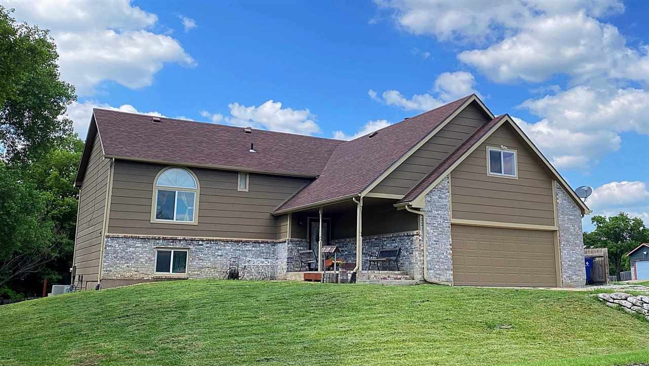 Beautiful corner lot home in desired Woodland Valley, Derby neighborhood!   From the exterior, this